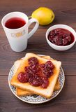 Toast with strawberry jam Stock Images