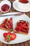 Toast with strawberry jelly and tea Stock Images