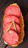 Toast with tasty chorizo Royalty Free Stock Image