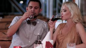 Toast to love, young, romantic date, loving couple in the restaurant, the evening for lovers, boys and girls in a stock video footage