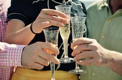A toast to a new life as man and wife. Cheers to the new marriage Stock Photos