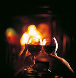 Toast to toast with red wine. Male and female pledge one`s word in the evening Stock Photography