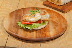 Toast, Toast bread, grilled turkey escalope, tomato, lettuce, ro Royalty Free Stock Image