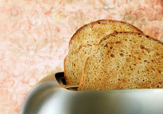 Toast in Toaster Stock Image
