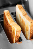 Toast in toaster Royalty Free Stock Images