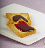 Toast. S with jam over a white plate Royalty Free Stock Photography