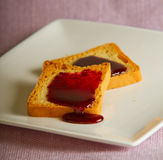 Toast. S with jam over a white plate Stock Photography