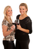 Toast - two girls with glass of wine Royalty Free Stock Photos