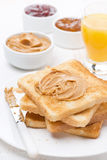 Toast with various jams and peanut butter, orange juice Royalty Free Stock Photos