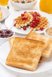 Toast, waffles, peanut butter, jam, muesli for breakfast Stock Images