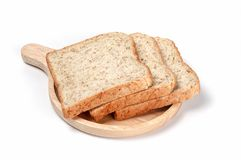 Toast wheat bread sliced on wooden plate royalty free stock images