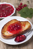 Toast of white bread with jam of red currant, a vase with jam Stock Photo