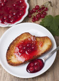 Toast of white bread with jam of red currant, a vase with jam Stock Photography