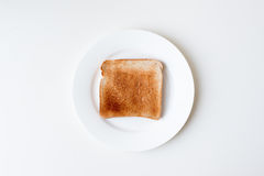 Toast on white plate from above Royalty Free Stock Photo