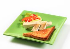 Toast and white rind cheese. Toasted bread and wedges of white rind cheese stock image