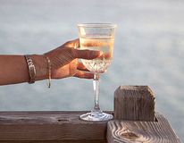 A toast in wine over the caribbean. A toast in wine ends the day in the Caribbean island of Cayman Brac Royalty Free Stock Image