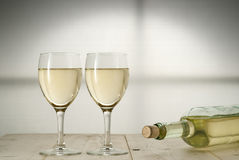 Toast wine. Toast white wine on natural wood Royalty Free Stock Photography