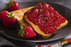 Toast With Cherry Jam Stock Photos