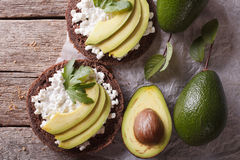 Free Toast With Cream Cheese And Avocado Close-up. Horizontal Top View Royalty Free Stock Images - 59285539