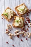 Toast With Peanut Butter And An Apple On Table. Vertical Top Vie Royalty Free Stock Photos