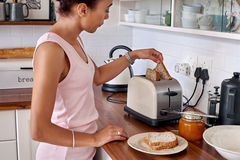 Toast woman kitchen Royalty Free Stock Photo
