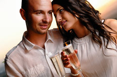 Toast young couple at sunset closeup Royalty Free Stock Images