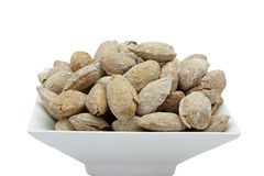 Toasted almonds. With shell in artisan wood-fired oven royalty free stock photography
