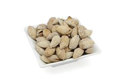 Toasted almonds. With shell in artisan wood-fired oven royalty free stock image