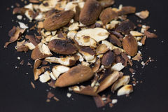Toasted almonds. On rustic background royalty free stock photography
