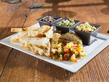 Toasted artisan bread with salsa and dips appetizer Stock Photo