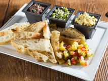 Toasted artisan bread with salsa and dips appetizer Stock Photos