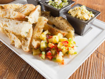 Toasted artisan bread with salsa and dips appetizer Royalty Free Stock Photo