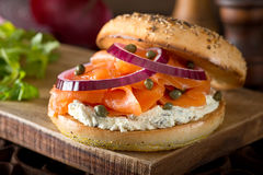 Toasted Bagel with Smoked Salmon and Cream Cheese. A delicious toasted bagel with smoked salmon, cream cheese, capers, and red onion Stock Image