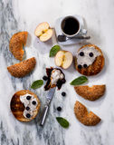 Toasted bagels with cream cheese plus coffee for morning meal Royalty Free Stock Image