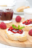 Toasted baguette with cream cheese, raspberry jam, raspberry Stock Photos