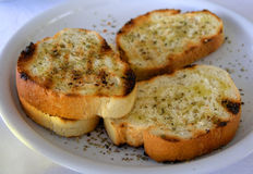Toasted bread. With olive oil and herbs on a white plate (greek Royalty Free Stock Photography
