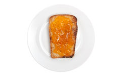 Toasted bread with apricot jam isolated on white. Healthy breakf Stock Image