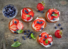 Toasted bread with berries and cream cheese Stock Image