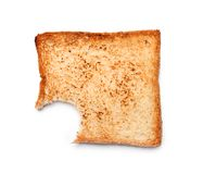 Toasted bread with bite mark on white background. Top view royalty free stock photo