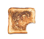 Toasted bread with bite mark. On white background, top view royalty free stock photo