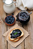 Toasted bread with blueberry jam Stock Photo
