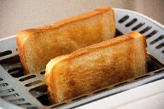 Toasted Bread on Bread Toaster Royalty Free Stock Photos