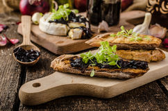 Toasted bread with brie cheese and caramelized onions Stock Image