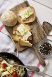 Toasted bread, with brie cheese and chives and tagliatelle with Stock Images
