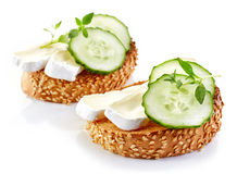 Toasted bread with brie and cucumber Royalty Free Stock Images