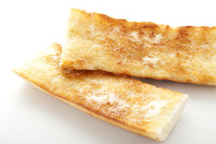 Toasted bread with butter Stock Images