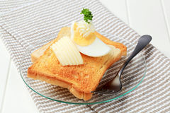 Toasted bread with butter and boiled egg Stock Photography