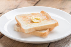 Toasted bread with butter. Stock Photo