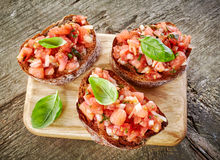 Toasted bread with chopped tomatoes Royalty Free Stock Photography