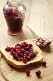 Toasted bread with cranberry jam Royalty Free Stock Photos
